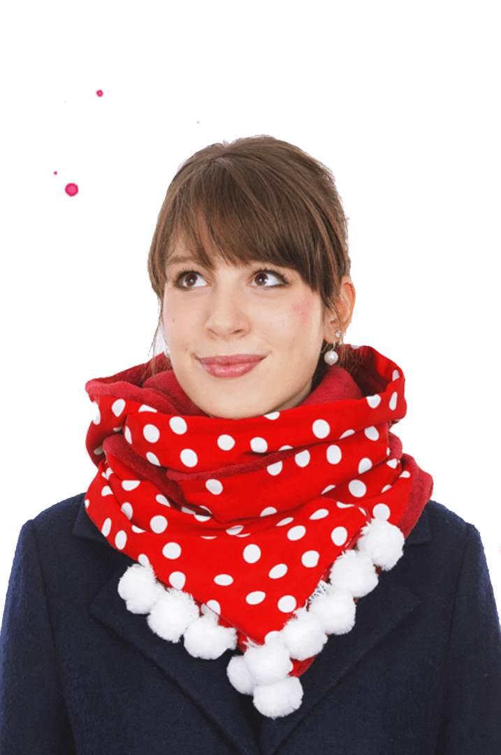 girl wears red dotted scarf collar with white bobble
