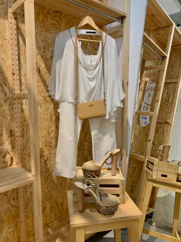 flowy top with white jeans and chunky sand coloured heels with a small tan coloured clutch.