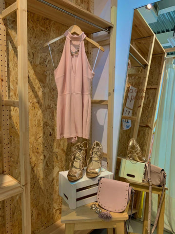 Dusty pink mini dress with matching pink bag and tan strappy heels.