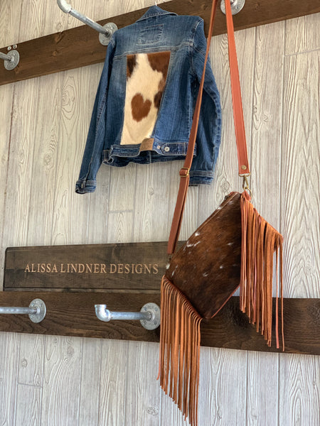 Cowhide crossbody with fringe