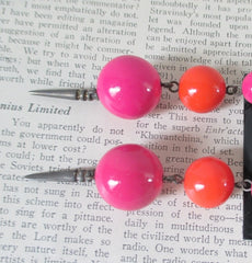 Vintage 80's Pink orange dangle glam earrings close up