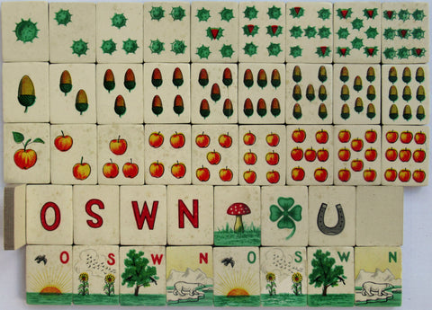 European mahjong set designed by Sala featuring mahjong tiles in German style playing cards