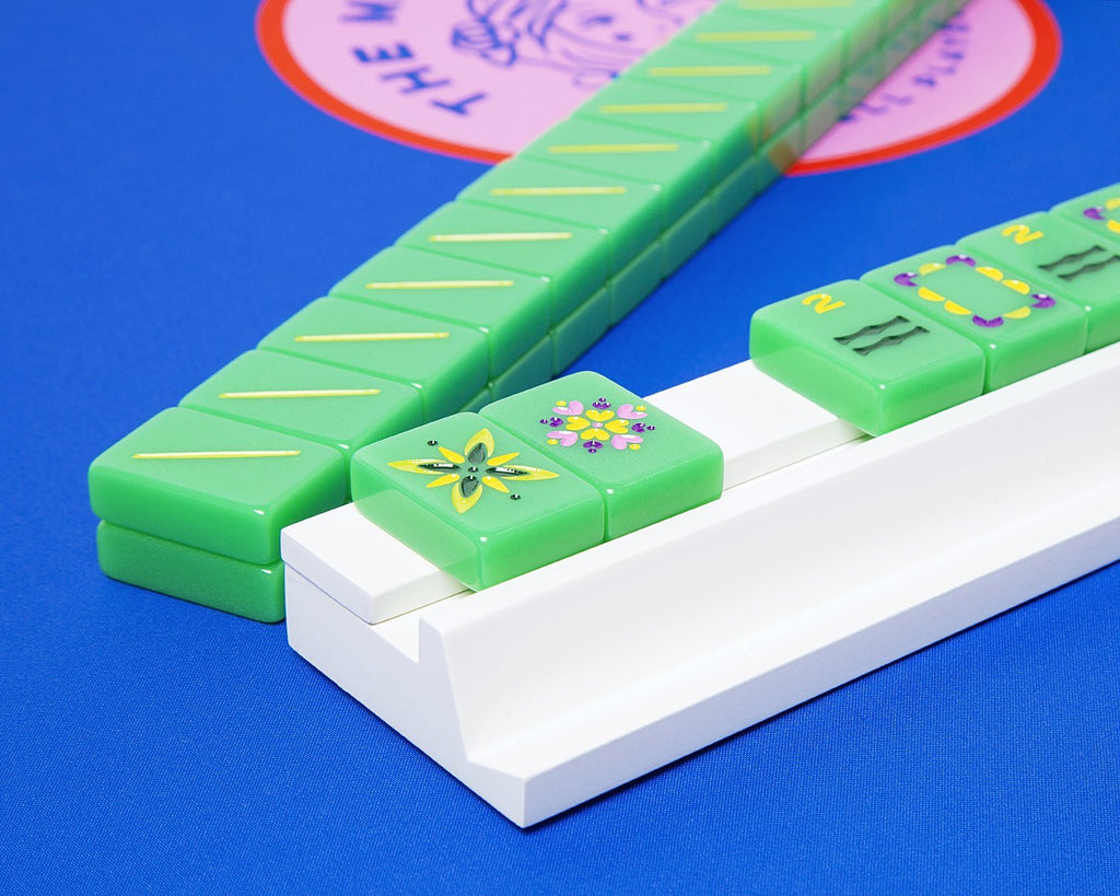Custom white wooden mahjong rack and pusher made for our custom mahjong tiles.