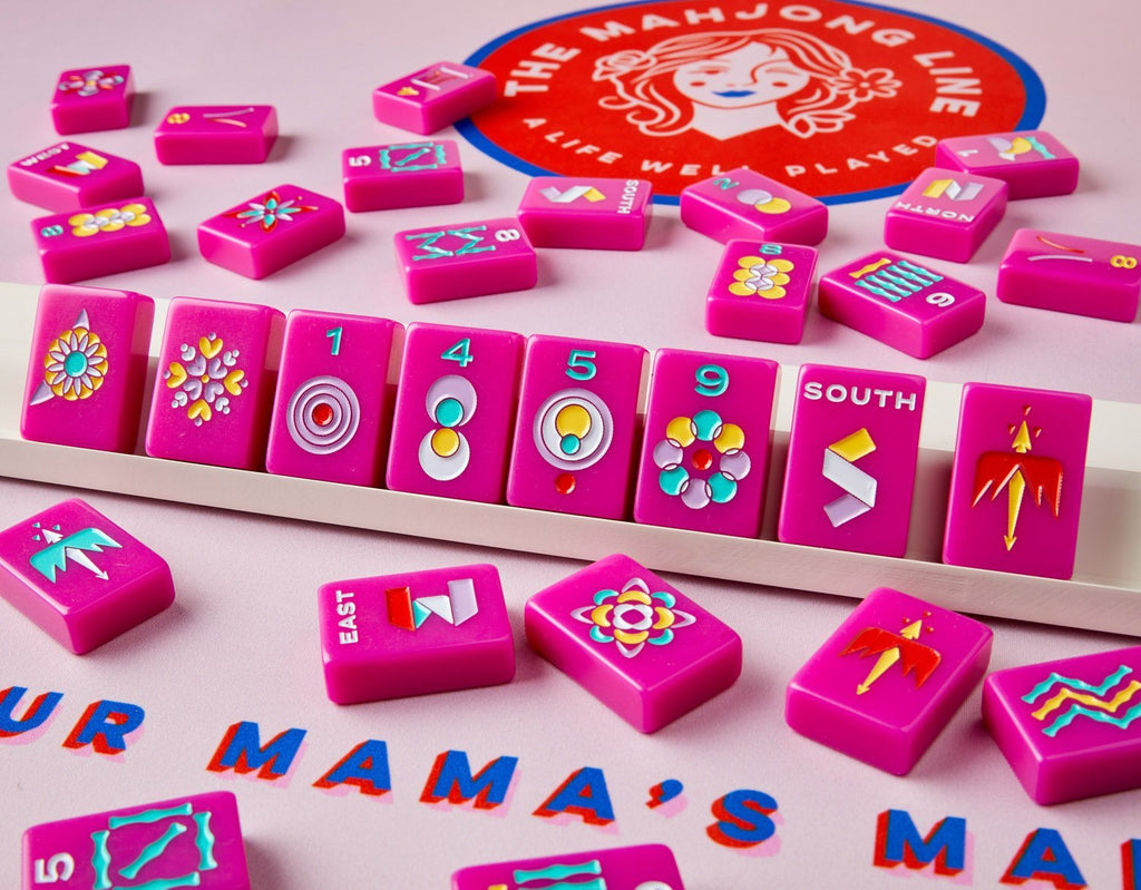 playing American mahjong using the pink minimal list on top of pink mahjong mat and rack