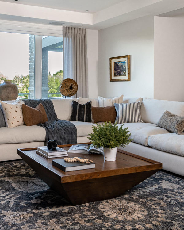 living room with oversized sectional and large rug.