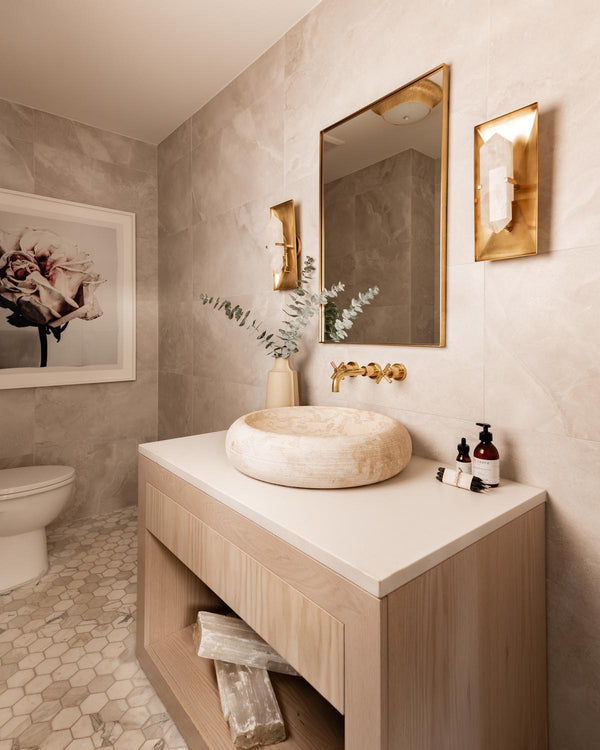 Luxurious bathroom with crystal wall sconces.
