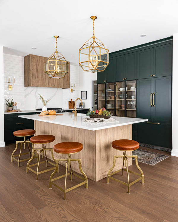 Gold light fixtures over kitchen island.