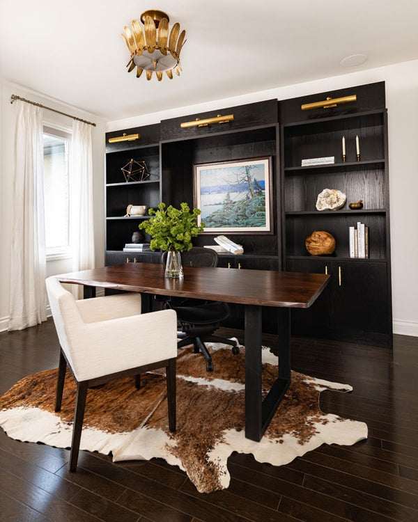customized home office with dark wood furniture.
