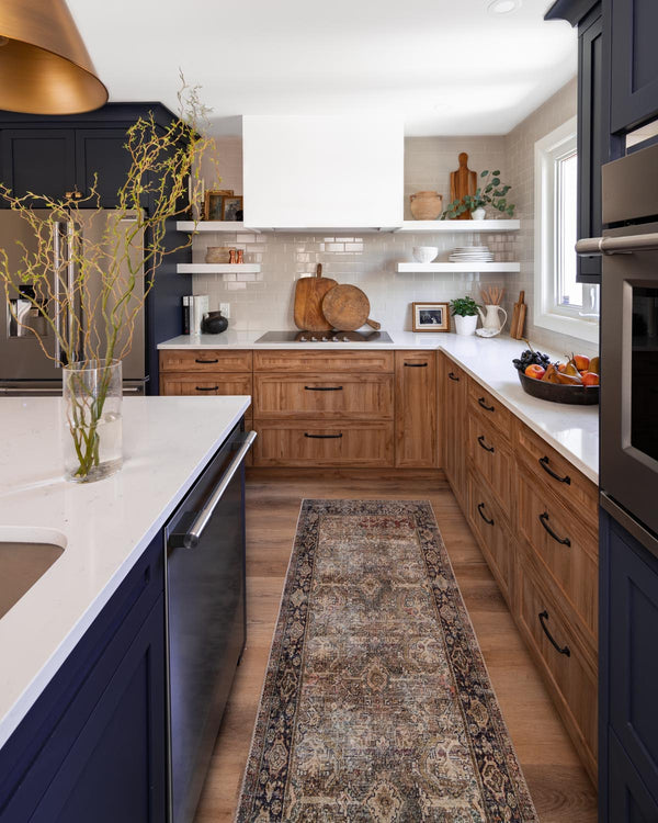 Two tone wood and navy kitchen with runner.