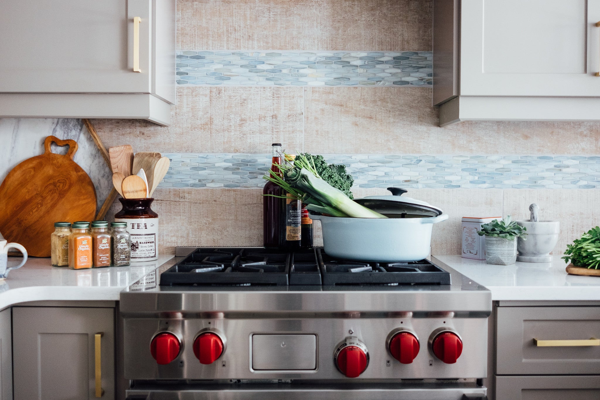 Kitchen interior design with stove and tile backsplash