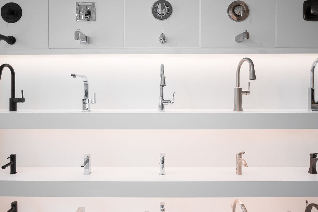Commercial Design studio. Various faucets for bathroom sink and shower.