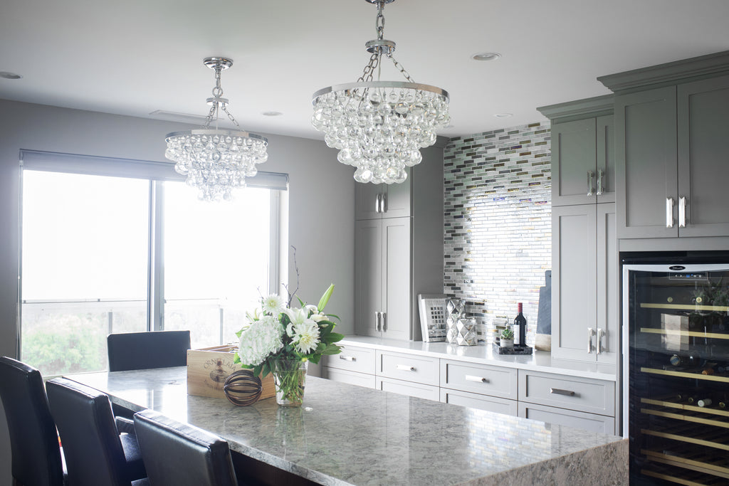 Kitchen island, chairs and chandeliers.