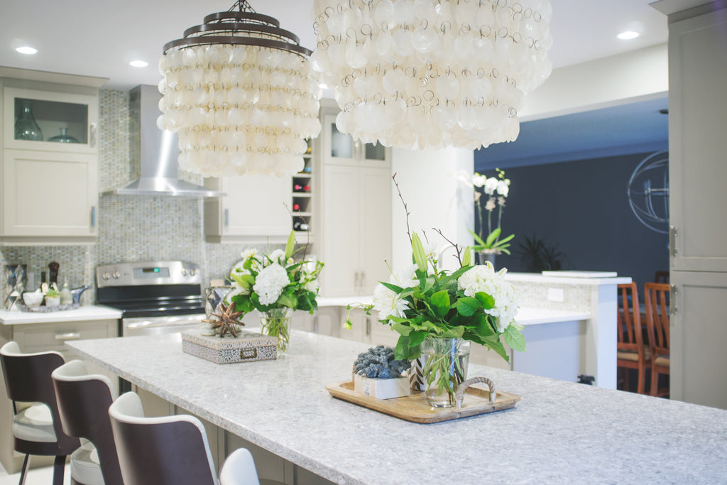 Kitchen island, chandelier and plants