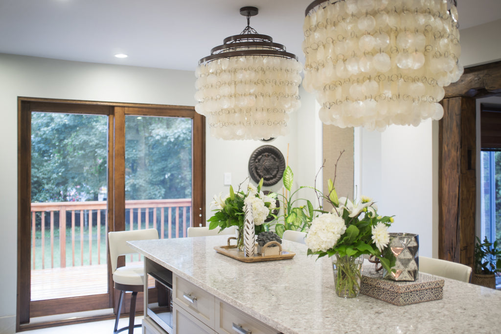 Natural chic kitchen, focus on island and chandeliers.