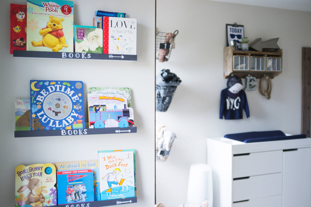 Book shelf and change table in boys room
