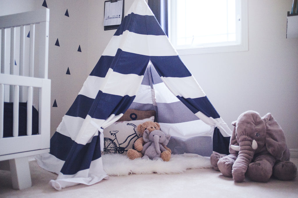 little blue tent in boys room with stuffed animals