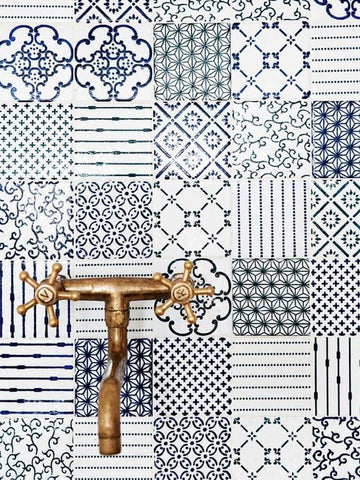 Close up on kitchen tiles and faucet