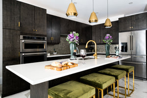 Luxury kitchen with brass finishes and dark millwork