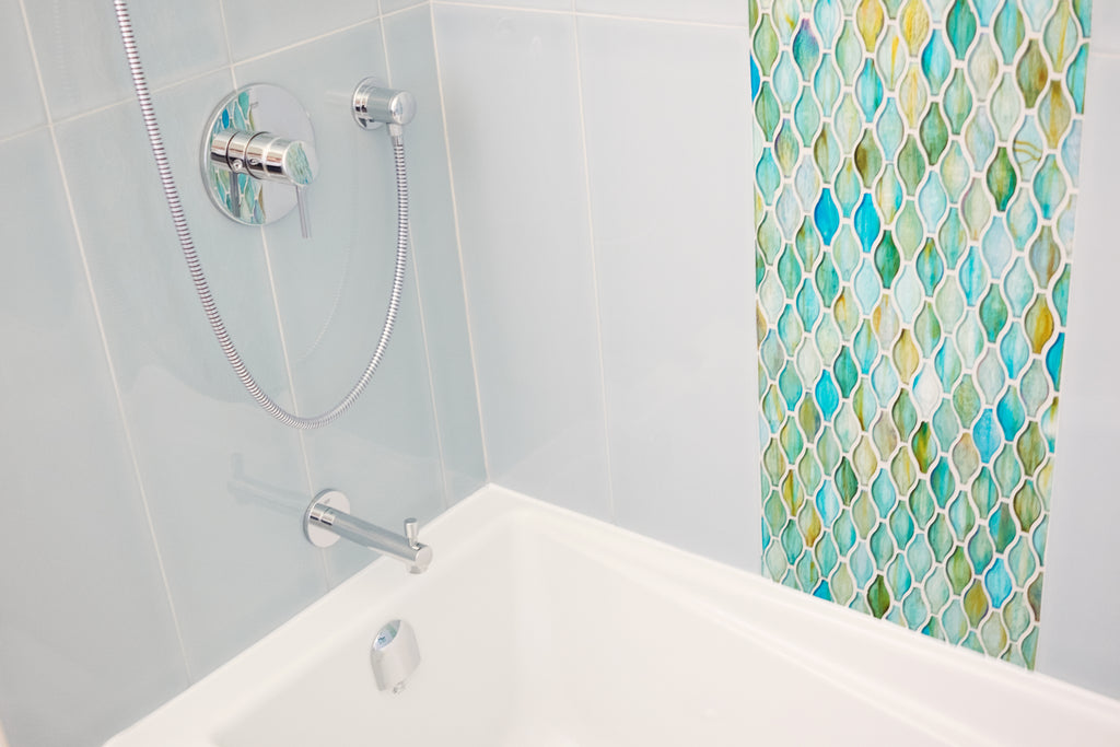 Westboro Infill bathtub focus on faucet and colourful tiles.