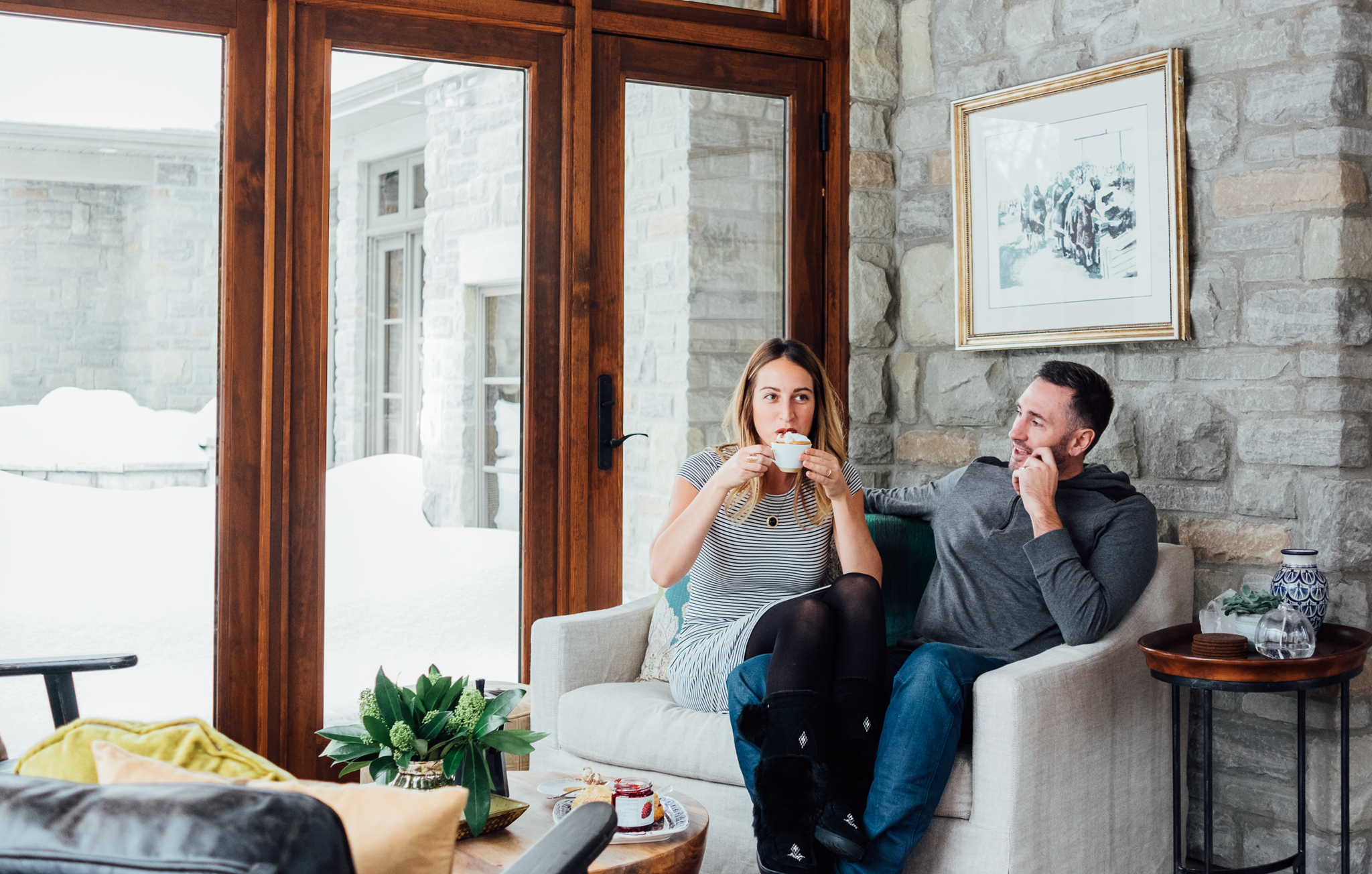 Couple sitting in living room drinking coffee