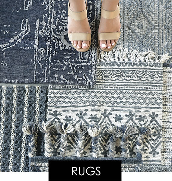 Blue rugs and runners with woman´s foot