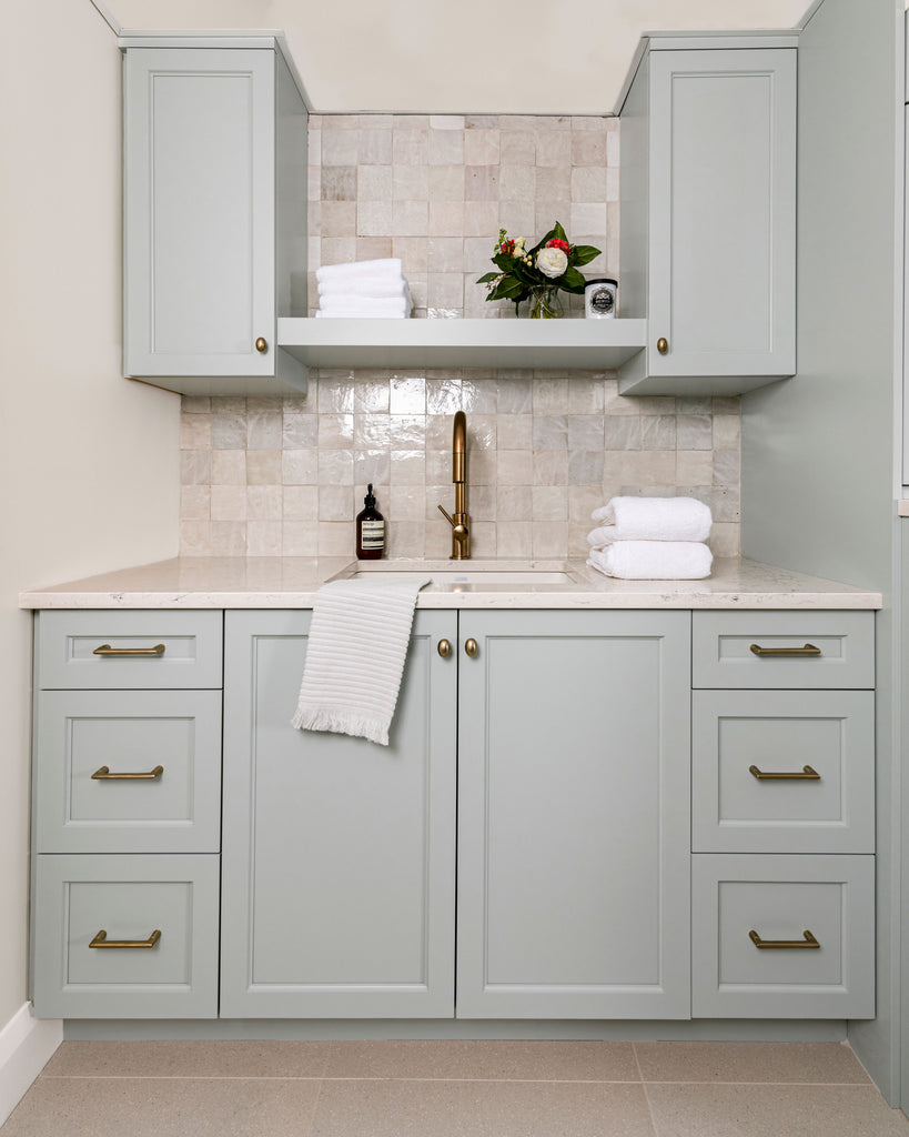 Laundry room cabinetry and sink.