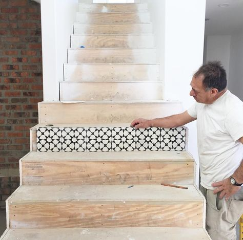 Tiles being installed on stairway