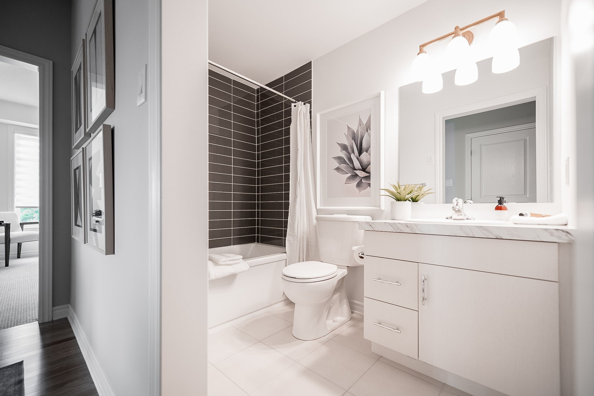 Alder Condo white bathroom design.
