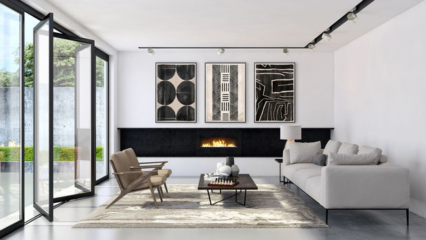 Collection of contemporary mud paintings in a modern living room.