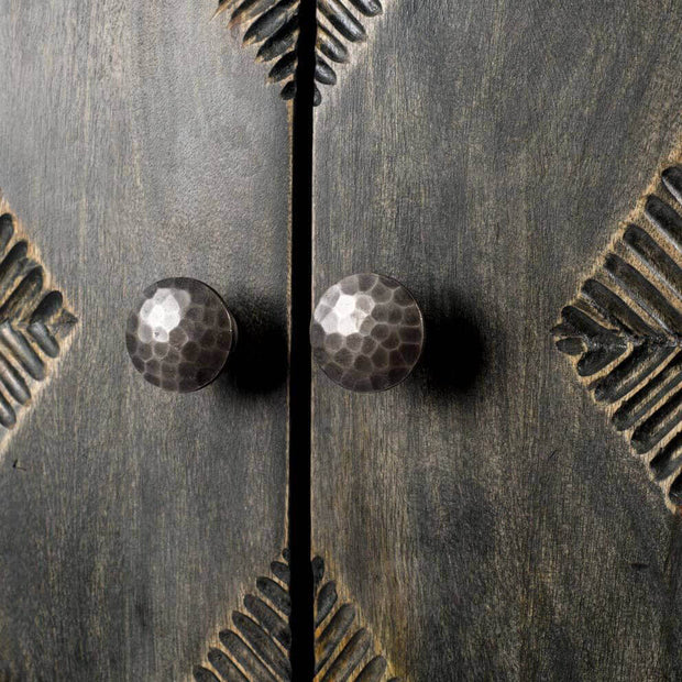 Dimpled knobs and carved details on the mid-century modern console table.