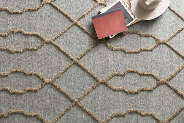 The Atlas Slate Rug in a lifestyle setting. High / low texture on a flatweave rug.