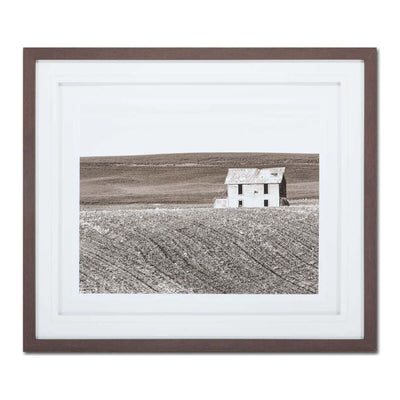 Abandoned House is a black and white photo print framed behind glass with a white mat.