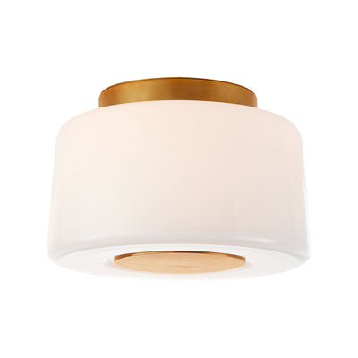 Circular flush mount ceiling light with glamorous and sophisticated soft brass elements and white glass.
