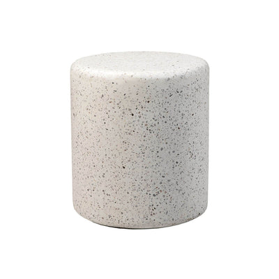 The Cecina Side Table is a white stone terrazzo drum shaped accent table.