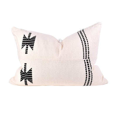 The Ngorongoro Pillow is a cream mudcloth throw pillow with a black embroidered graphic pattern.
