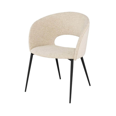 Retro inspired dining room chair with a textured boucle upholstered seat and matte black legs.