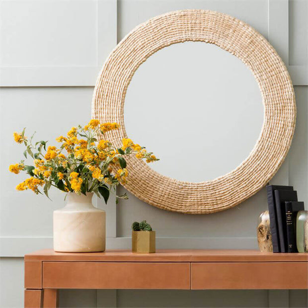 Natural looking, circular frame in an entry way.