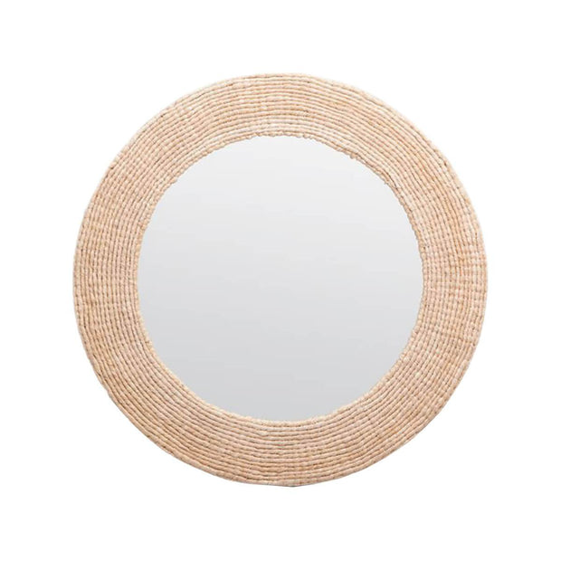 The Chapelton Mirror is a circular mirror with a woven, organic frame.