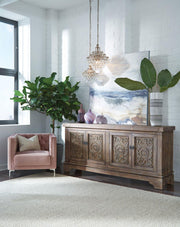 Bohemian sideboard with hand-carved details and lots of storage in a living room.