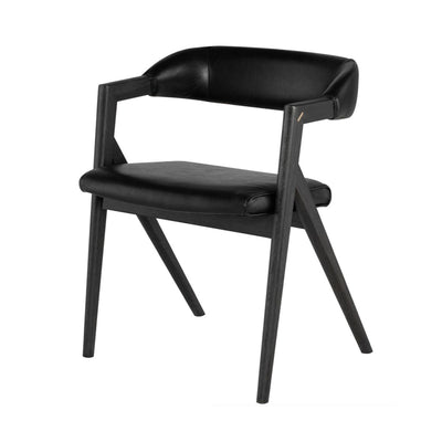 A modern and comfortable black leather dining chair with a curved back and sloped seat made of faux black leather.