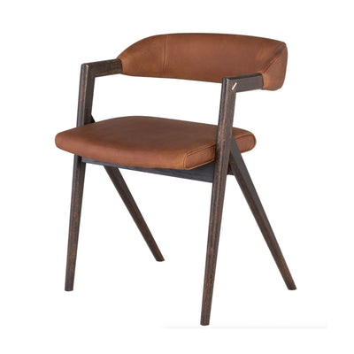 This modern dining chair is made of a cognac leather seat with a seared oak wood frame.