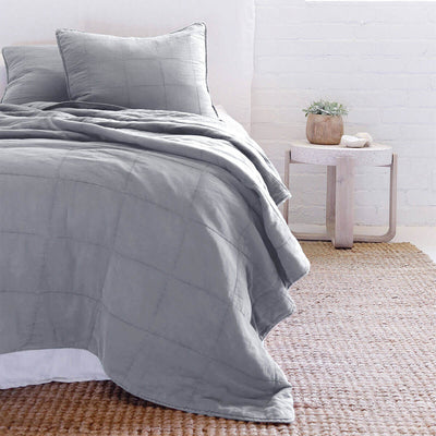The Fira Bedding Collection in blue is 100% cotton and has a large quilted pattern.