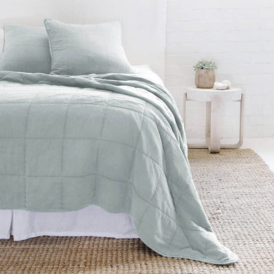 The Fira Bedding Collection in sky is 100% cotton, has a large quilted pattern, and is available in a variety of sizes.