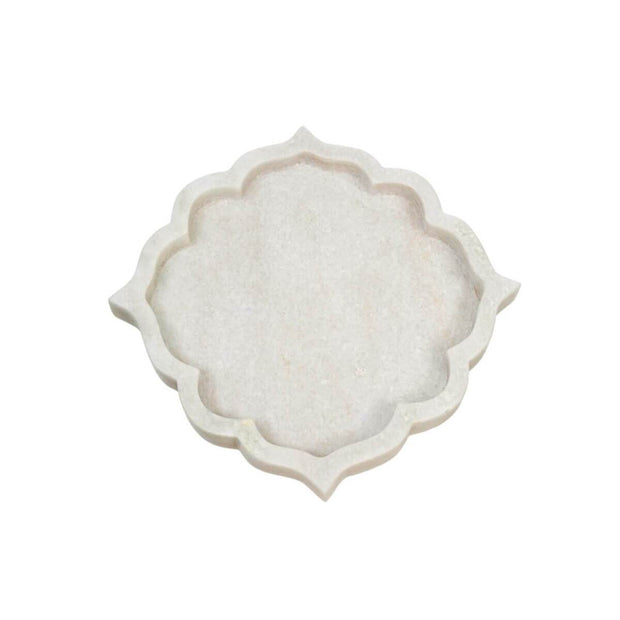 The small Girona Marble Tray has an arabesque shape and is hand-carved from white marble.