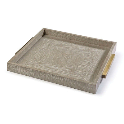 This grey shagreen tray is perfect for decorating a coffee table. The weathered brass hardware adds a glamorous touch to this piece.