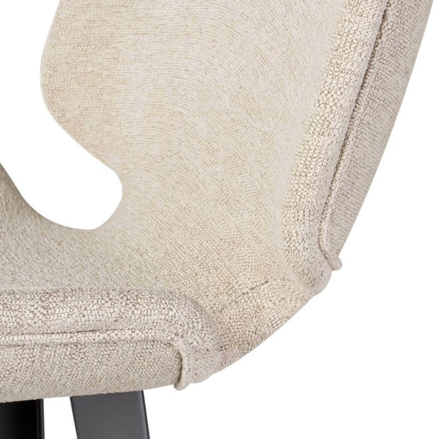 Boucle upholstered seat and seaming details on the modern counter stool.