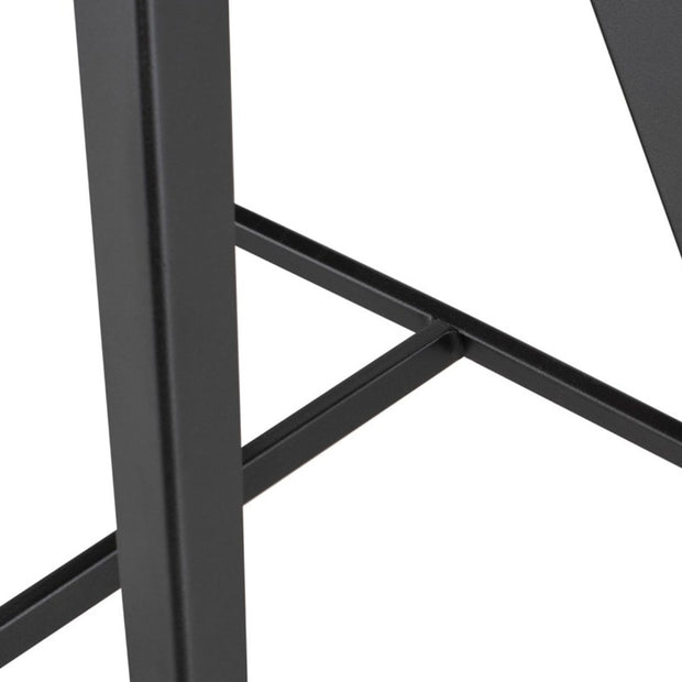 Dark steel legs on the retro-inspired counter stool.