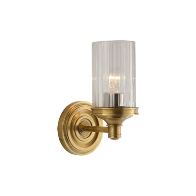 A classic piece combining hand-rubbed antique brass with crystal glass.