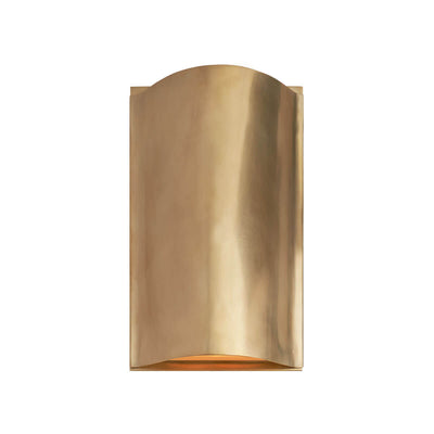 The Avant Curve Wall Sconce is a modern sconce made of curved, antique burnished brass metal and an interior light.