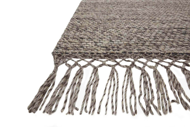 Fringe and texture details on the Calacatta Grey Rug. Natural, wool rug with fringe.